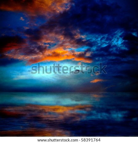 dramatic cloudscape over water - stock photo