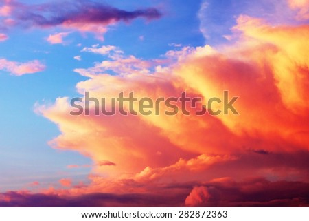 dramatic cloudscape with red sunlight at sunset - stock photo