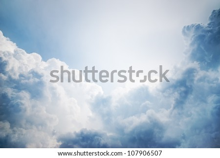 dramatic cloudscape with sunlight in the background - stock photo
