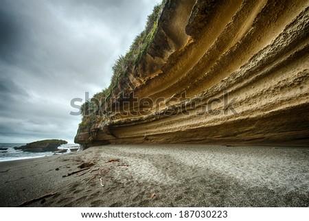 Dramatic coastal cliff on the Truman track, not far from Punakaiki. Paparoa National Park, New Zealand - stock photo