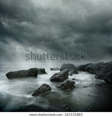 Dramatic Coastal Scene. Sea Storm Long Exposure, Rugged coast line and swirling waters. - stock photo