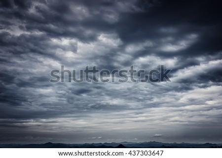 Dramatic dark clouds before thunderstorm rain - stock photo