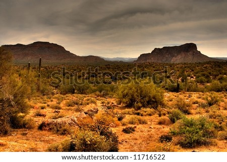 Dramatic desert mountains with a storm approaching - stock photo