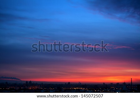 Dramatic evening cloudscape in city - stock photo