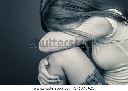 Dramatic image of a sad teenage girl crying - stock photo