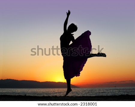 Dramatic image of a woman dancing by the ocean at sunset - stock photo
