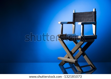 Dramatic lit Director's Chair - stock photo