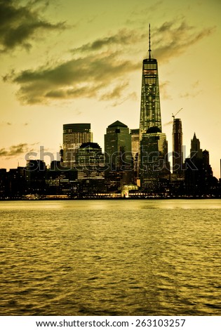 Dramatic lower Manhattan skyline with dark filter - stock photo