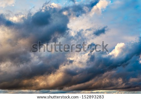 Dramatic morning sky with dark rain clouds - stock photo