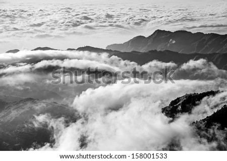 Dramatic mountain scenery with clouds move like waterfall or river around the mountain, shot at Yushan National Park, Taiwan, Asia. - stock photo