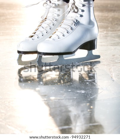 Dramatic natural portrait shot of ice skates - stock photo