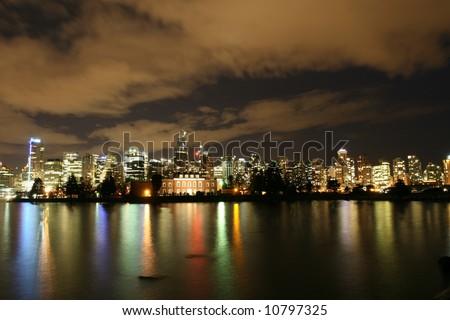 Dramatic Night Sky Illuminated By City Core - stock photo