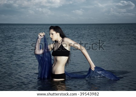 Dramatic photo of the woman in the water - stock photo