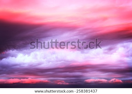 Dramatic pink clouds on sunset sky as background - stock photo