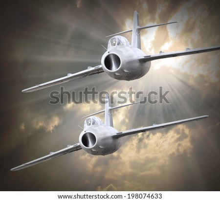 Dramatic scene on the sky. Old jet fighter planes inbound from sun. Retro technology background.  - stock photo