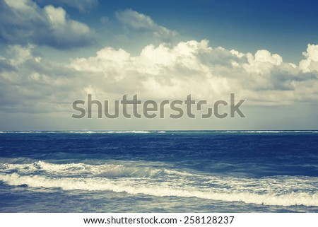 Dramatic sea landscape, Atlantic ocean coast. Dominican republic, Punta Cana. Blue toned photo with instagram filter effect - stock photo