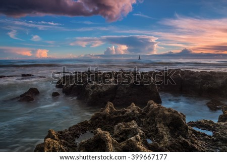 Dramatic seascape sailing ship in the distance.  - stock photo
