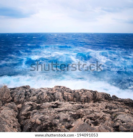 Dramatic seascape with danger waves. Neutral densitiy filter used to make blurry waves. - stock photo