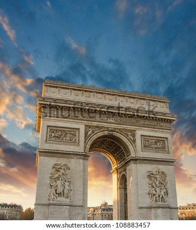 Dramatic sky above Arc de Triomphe in Paris, France - stock photo
