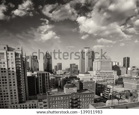 Dramatic sky above Montreal Buildings, Canada - Aerial view. - stock photo