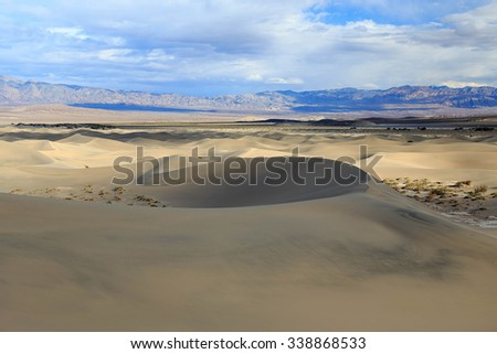 Dramatic sky above the sand dunes, Death Valley, California, USA. - stock photo