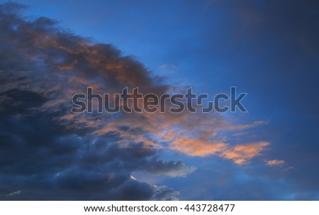 Dramatic sky and clouds after a thunderstorm on a summer evening. - stock photo