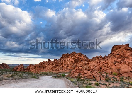 Dramatic Sky and Road Through Desert Landscape - Valley of Fire, Nevada - stock photo