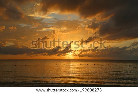 Dramatic sky at sunset, Negril, Jamaica - stock photo