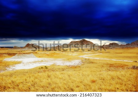 Dramatic sky on Badlands National Park, South Dakota, United States - stock photo