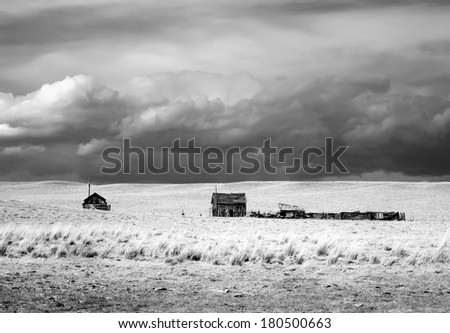 dramatic sky on Rural grasslands, Colorado, United States, black and white version - stock photo