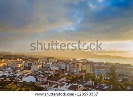 Dramatic sky over city Ponta Delgada, Azores, San Miguel (Sao Miguel) island. Early morning - stock photo