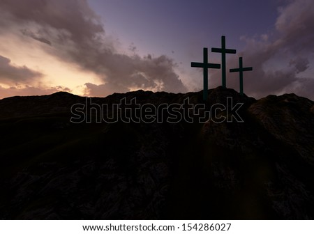 Dramatic sky silhouettes three wooden crosses with shafts of sunlight breaking through the clouds - stock photo