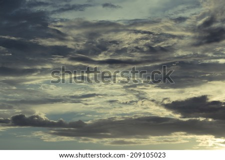 dramatic  sky with clouds and sunbeams - stock photo
