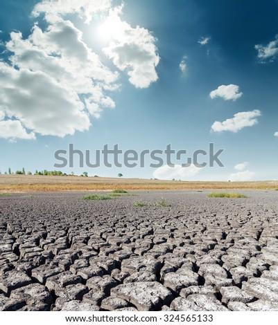 dramatic sky with sun over desert - stock photo