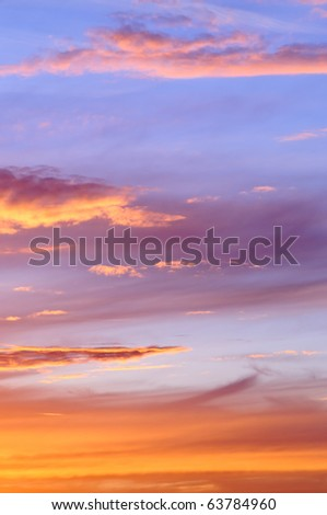 Dramatic sky with sunlit clouds at dusk - stock photo