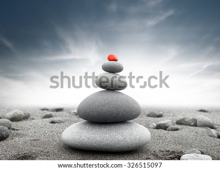 Dramatic spiritual background of zen-like stone pyramid. Tranquil and calm concept  - stock photo