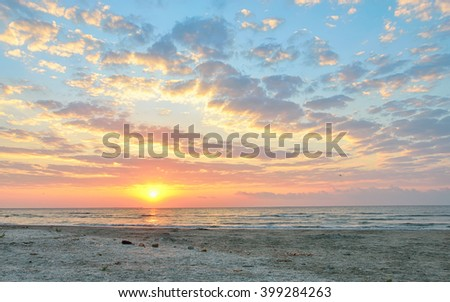 dramatic summer sunset sky and sea - stock photo