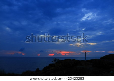 Dramatic Sunrise Lighting and Easter Cross:Select focus with shallow depth of field. - stock photo