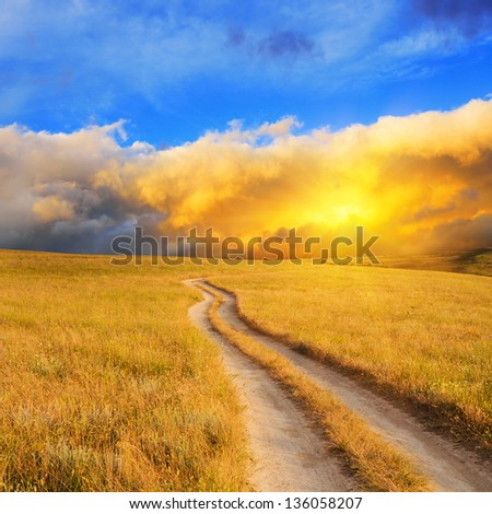 Dramatic sunrise over the meadow. Summer landscape. - stock photo