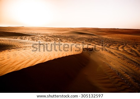 Dramatic sunrise view of Liwa Desert in the western region of Abu Dhabi, UAE - stock photo