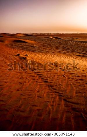 Dramatic sunrise view of the Liwa Desert in the Western Region of Abu Dhabi - stock photo
