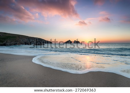 Dramatic sunset at Holywell Bay, a large sandy beach near Newquay in Cornwall - stock photo