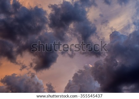 Dramatic sunset cloudscape useful for background or texture. - stock photo
