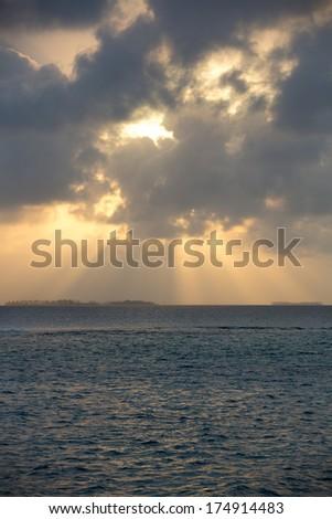 Dramatic sunset on a remote paradisiac island in San Blas Islands, Panama 2014. - stock photo
