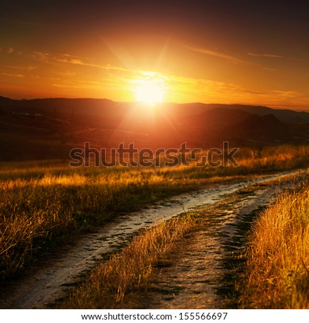 Dramatic sunset over autumnal valley, natural landscape - stock photo