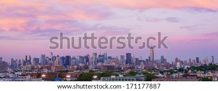 Dramatic sunset over New York City - stock photo