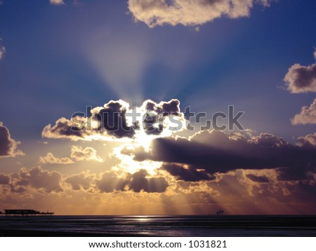 Dramatic sunset over sea - stock photo
