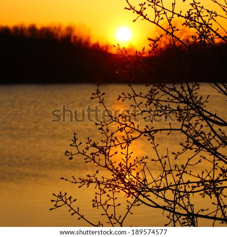 Dramatic sunset over the lake - stock photo