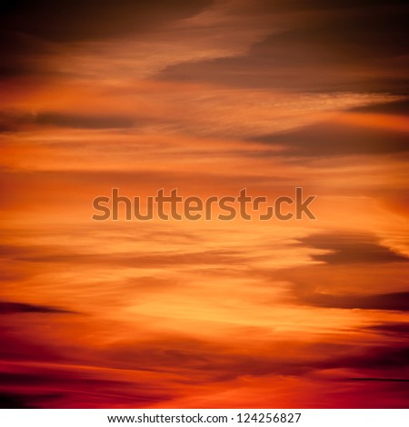 Dramatic sunset over the sea. Sky background - stock photo