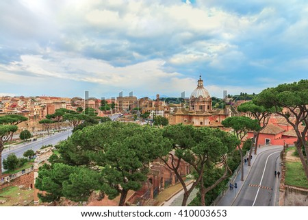 Dramatic sunset sky above the Great Roman Colosseum (Coliseum, Colosseo, Flavian Amphitheatre), church of Santi Luca e Martina and the Roman Forum. Beautiful aerial panoramic view. Rome.Italy.Europe. - stock photo